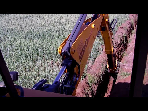 Digging sewer trench