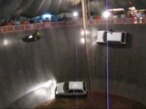 cars & motorbikes riding on the walls of death, flying, india, rajastan, udaipur, divali festival