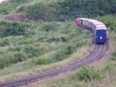 Neral-Matheran toy train can be seen climbing up the hill with lots of