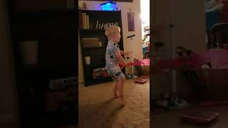 Toddler original song performed on his Mickey guitar.
