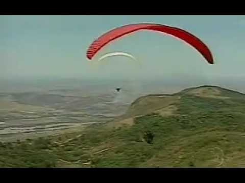 Pilot dies in crash with paraglider.