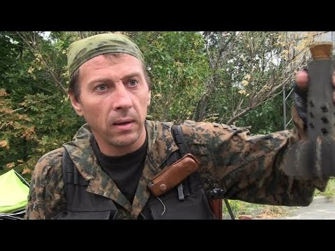Rebels in Donetsk say shells continue to fall despite truce