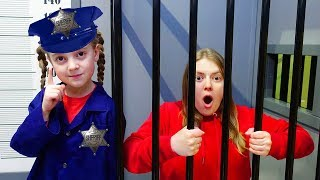 Ulya and mommy play police and toy jail playhouse