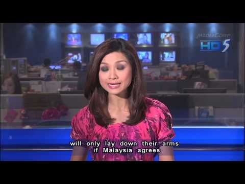 Philippines' Aquino warns sultan in Malaysia stand-off - 26Feb2013