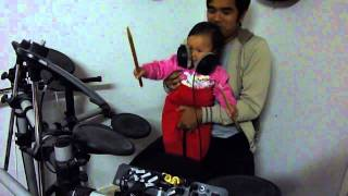Bethany, at 15 months, playing drums