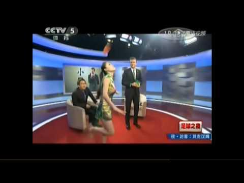 David Beckham kicks a shuttlecock at a TV show in China