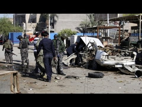 Dozens killed in Baghdad bomb blasts on 10th anniversary of Iraq invasion