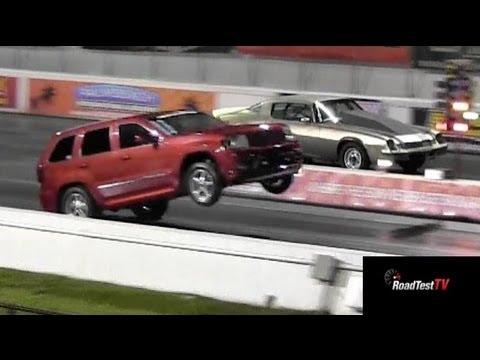 Fastest NA SRT 8 Jeep Cherokee vs Big Block Camaro  - Wheelstand - Drag Race Video -- Road Test TV®