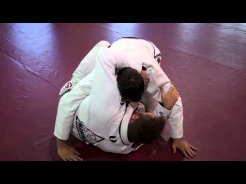 BJJ Lapel Choke from bottom of Half Guard Image 1