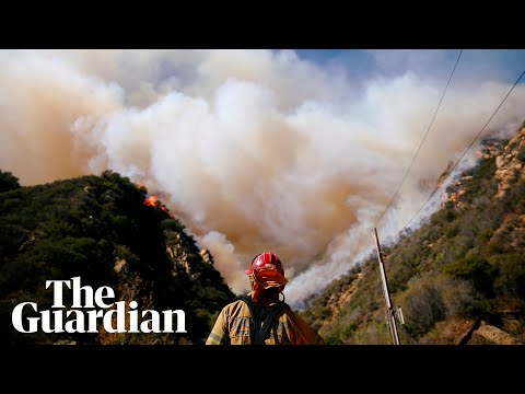 California wildfires: rescuers search for victims as winds fuel flames