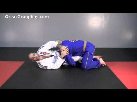 Half Guard Pass Defense Push on Face Image 1