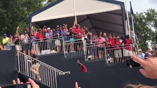 Tiger Woods walks off the 18th at Bellerive CC and waves to St. Louis fans