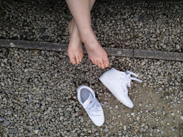 Her Reebok Freestyle shoeplay