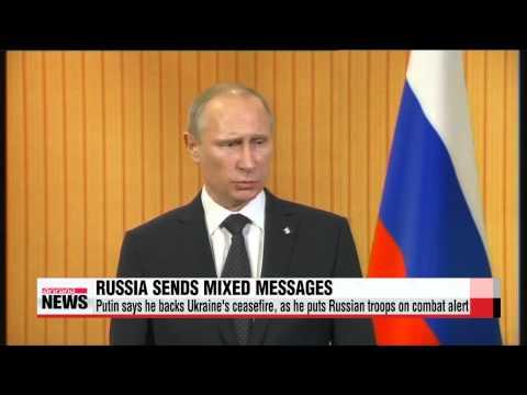 Putin says he backs Ukraine's ceasefire, as he puts Russian troops on combat alert