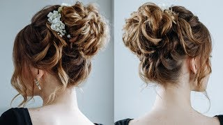 High curly messy bun\ the topknot updo