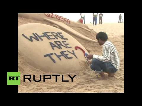 India: See AirAsia QZ8501 & MH370 artist question official truth in SAND SCULPTURE