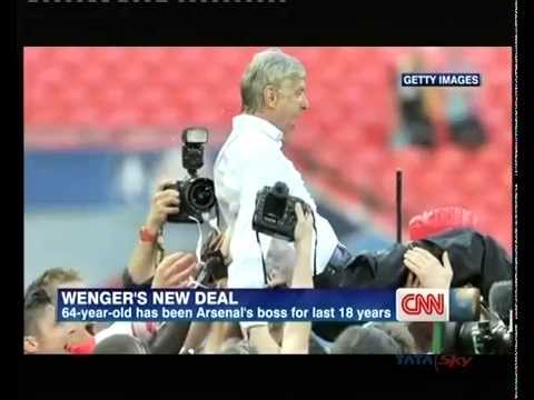 Wenger signs new 3-year deal