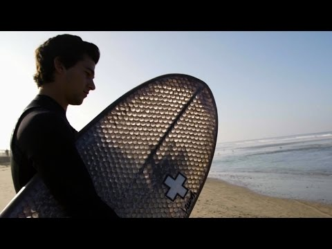 Riding Waves on a Cardboard Surfboard