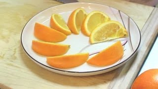 How to Cut an Orange Lengthwise : Fruit Cutting Tips