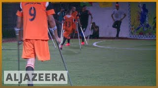 Playing football brings hope to amputees in Gaza | Al Jazeera English