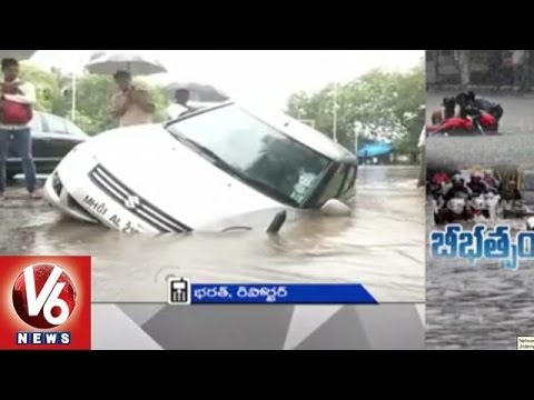Heavy rain disrupts normal life in Mumbai l V6 News (19-06-2015)