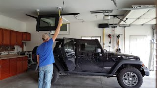 Custom 4-point lift for a Jeep hardtop with electric hoist