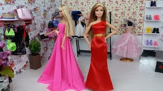 Two Barbie sisters in the shop dress up. New dress for Barbie doll.