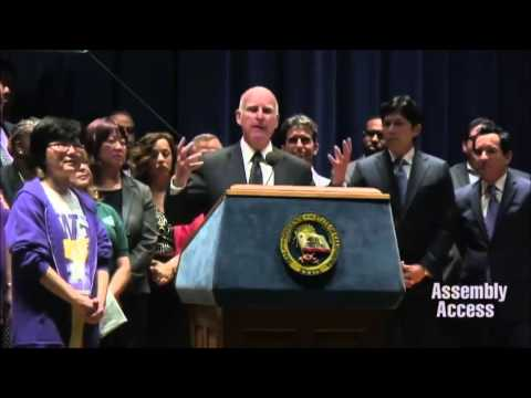 Gov. Jerry Brown admits minimum wage laws don't make economic sense, as he signs minimum wage law