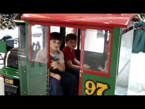 kids riding christmas train @ volusia mall