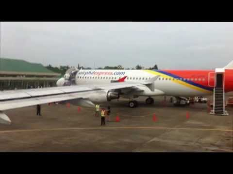 AIRLINE TRAVEL & AIRPORTS: Philippine Airlines A320 Landing in Puerto Princesa