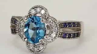 Blue Topaz Oval Set In Diamond And Sapphire Antique Ring