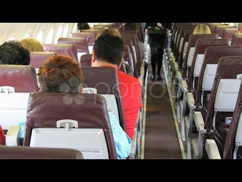 Flight Attendant On Plane. Stock Footage
