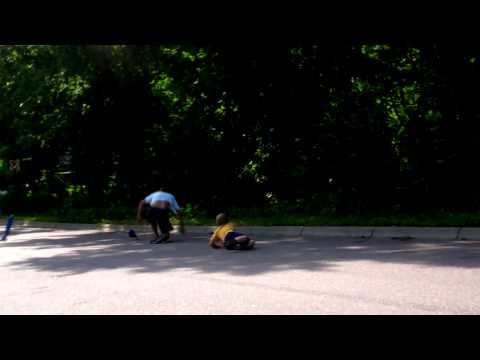 Longboarder hits kid (Fail)