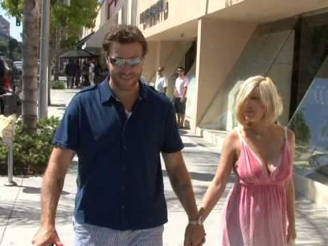 Tori Spelling and Dean McDermott chat as they stroll through Beverly Hills.