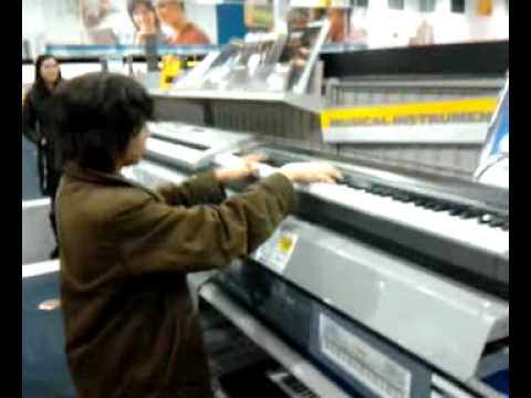Best buy kid plays super mario!