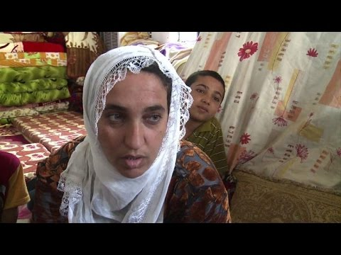 Facing new flight, Turkish Kurds in Iraq long for home