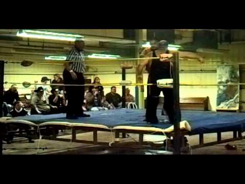 "J.C. Dykes Jr. with Siren Vs. ""Mad Dog"" Dave Lynch in Marlinton, WV in a Double Dog Collar Match. Winner: ""Mad Dog"" Dave Lynch."