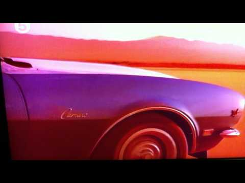 Jodie Kidd doing the Route 66 thing in a Camaro Z28