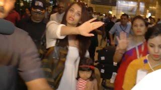 Aishwarya Rai Bachchan protects Aardhya from media @ Airport