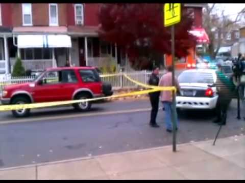 Scene where child was struck on South Ann St. [raw video]