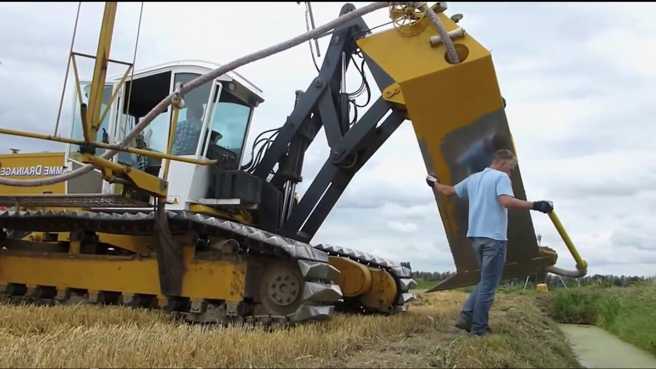 Tractors Pulling Plowing Power- Field Drainage
