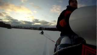 Pulling Stiga snowracer after Snowmobile