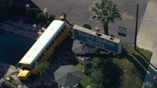 School bus crashes into motel pool area