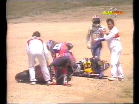 Mick Doohan & Pier Francisco Chili in an amazing double highside.It's at 28 seconds if you can't be bothered to wait!! Or 1min onwards for the slo-mo replay!...