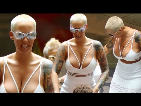 Amber Rose Shows Off Some Extreme Cleavage In White Low-Cut Dress !! thumbnail