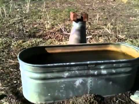 Off The Grid Rocket Stove Hot Tub Finished And On Fire