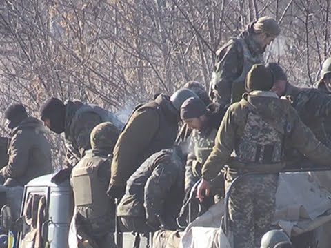 Raw: Ukraine Troops Withdraw From Town