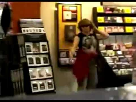 Crazy Lady Dancing At CD Store