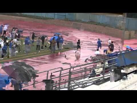 2011 SMHS Track - First heat of men's 100 meters intra-squad time trial in the rain