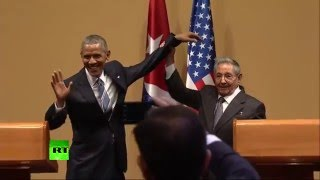 No hugs for Obama Akward moment with Castro at Havana presser   YouTube